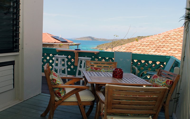 Outside dining on deck with views of Cruz Bay