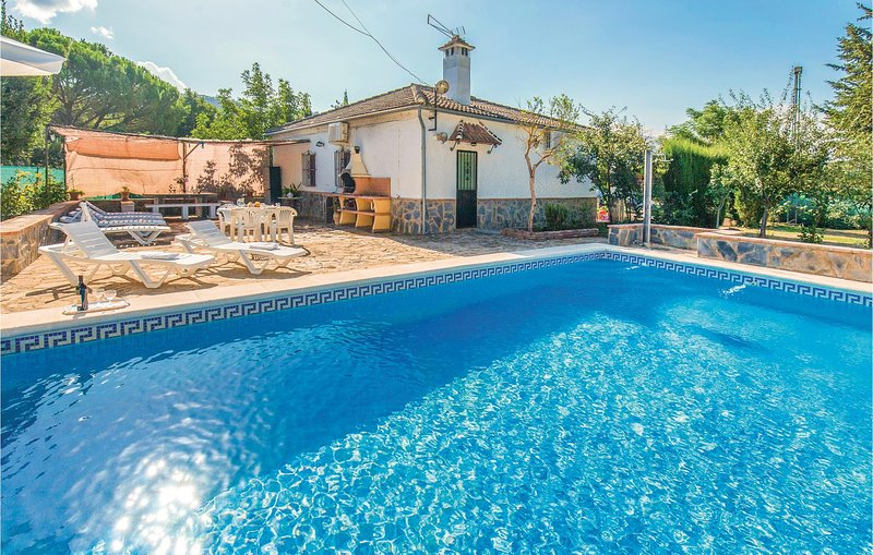 Awesome home in Ronda with WiFi, Outdoor swimming pool and Outdoor swimming pool, holiday rental in Benaojan