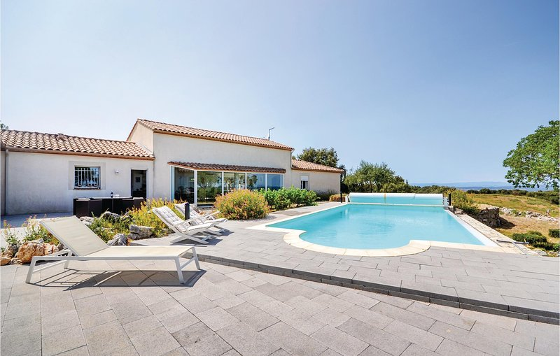 Beautiful home in Poulx with WiFi, 5 Bedrooms and Outdoor swimming pool (FLG443), vacation rental in Sanilhac-Sagries