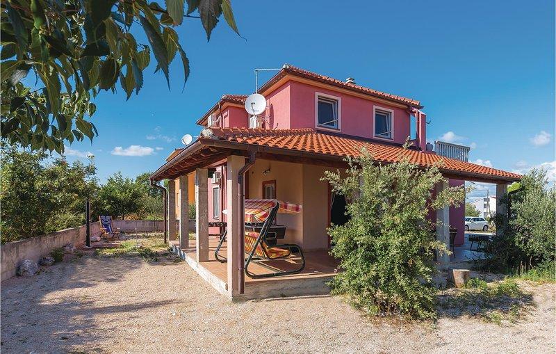 Stunning home in Sibenik with WiFi and 5 Bedrooms (CDV498), holiday rental in Jadrija