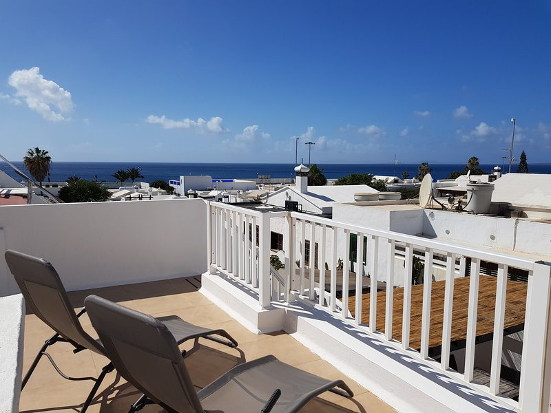 Relax and admire the view from the upper terrace