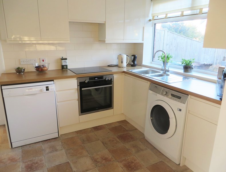 The newly refurbished kitchen is bright and spacious