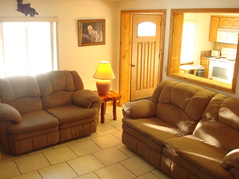 The comfortable living room is perfect for relaxing after a day of fun and adventure.