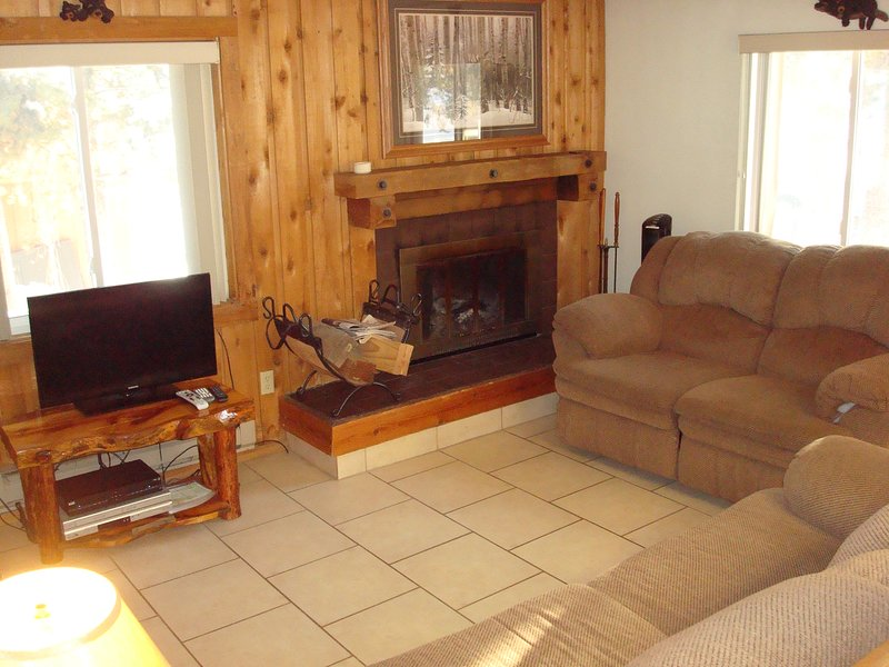 Lodgepole Townhome has a cozy living room with a wood burning fireplace (and wood included!)