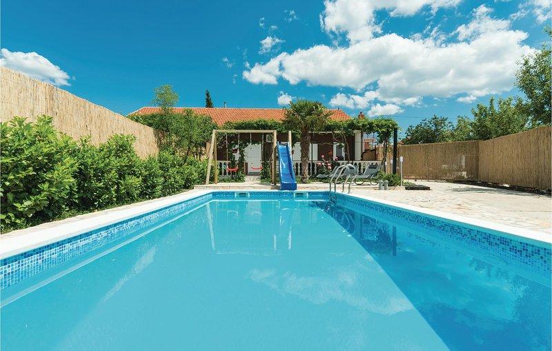 Amazing home in Sibenik w/ WiFi and 2 Bedrooms (CDJ414), holiday rental in Pakovo Selo