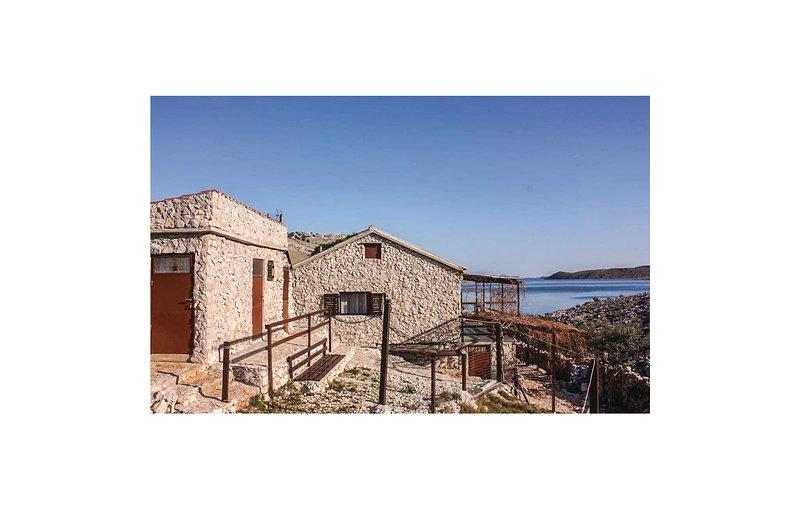 Nice home in Kornati with 4 Bedrooms (CDJ464), casa vacanza a Kornat Island