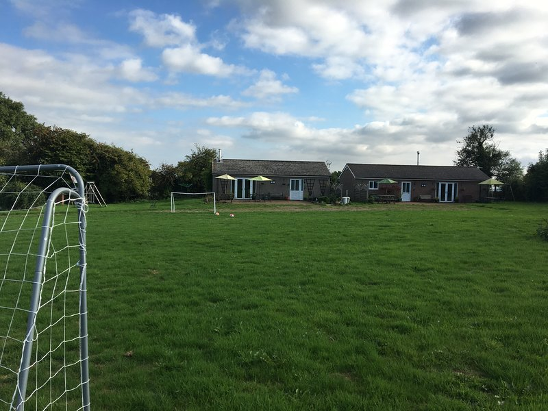 Photo of Blackthorn Lodge (left) and Hawthorn Lodge (right) taken from the goal posts