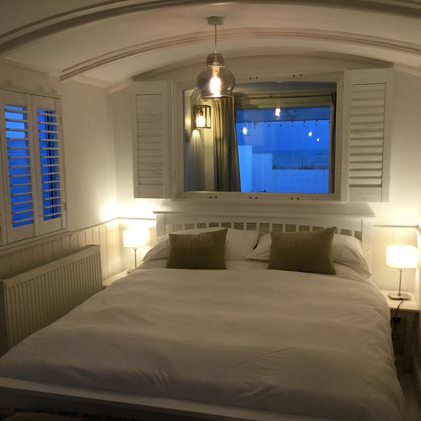 Sea views from the main railway carriage bedroom.