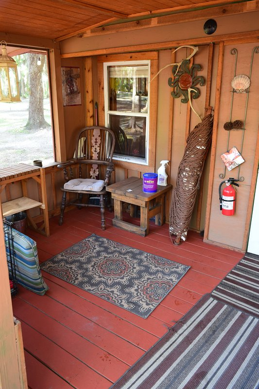 Porch sitting area with dog kennel