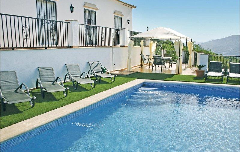 Beautiful home in Iznájar with 3 Bedrooms (EAC089), holiday rental in Cuevas De San Marcos
