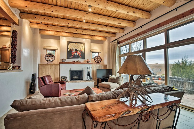 Relish in style and mountain views as you vacation in this Santa Fe abode.