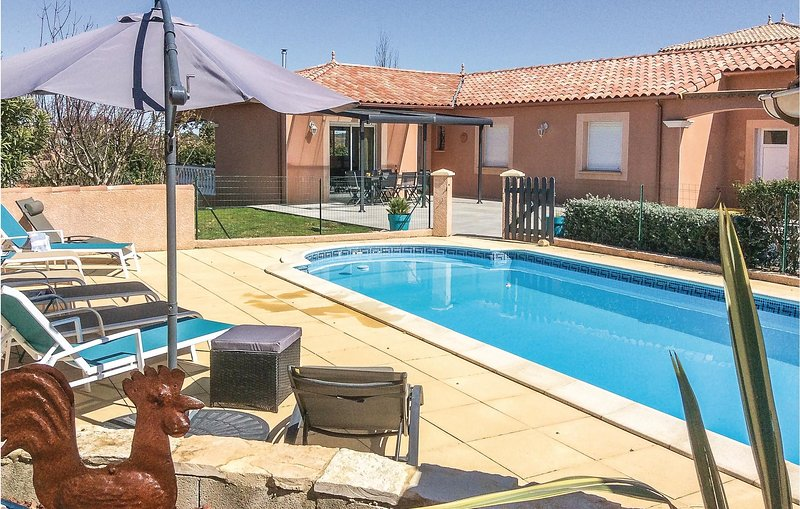 Nice home in Puimisson with Outdoor swimming pool, WiFi and Outdoor swimming poo, holiday rental in Pailhes