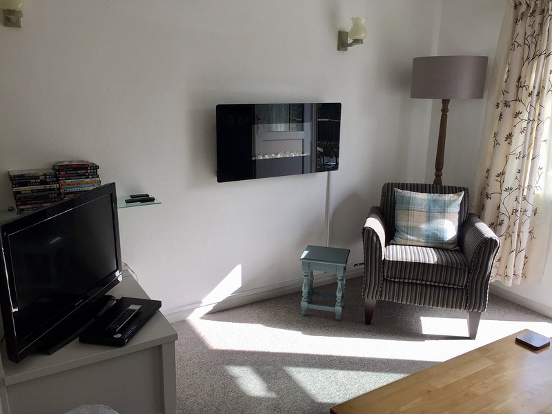 Living room leading to balcony, The Retreat apartment, Polperro