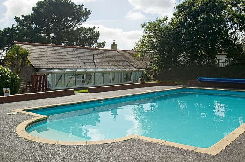 Communal heated outdoor pool at Willingcott Valley