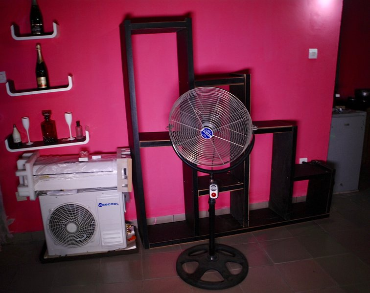 air conditioner or fan for condensed air to refresh you, furnished clothes, shelves
