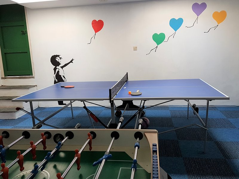 Play area with table tennis and table football.