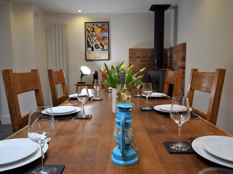 Enjoy family meals around the refactory table in this coastal retreat