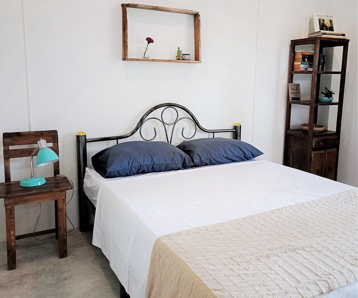 Queen-size bed in a cool airy room. There are books to red and a bedside lamp. Private bathroom.
