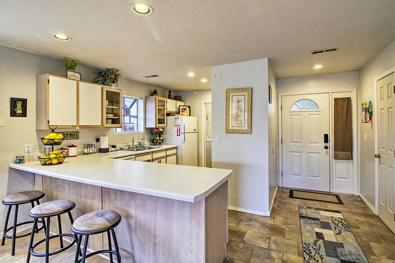 The vacation rental condo features a fully equipped kitchen.