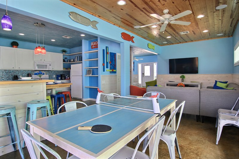 Ping pong table doubles as a dining room table for larger families.