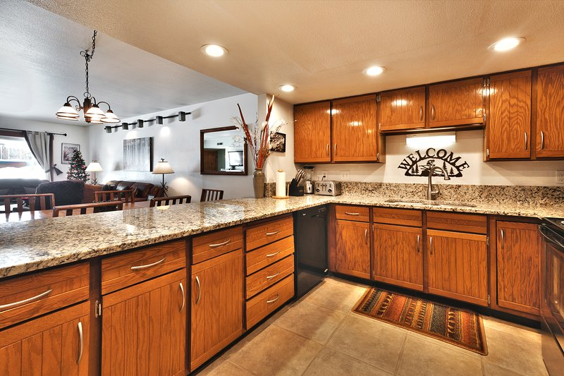 Big Well Stocked Kitchen with Granite Counter Tops and Stainless Steel Appliances