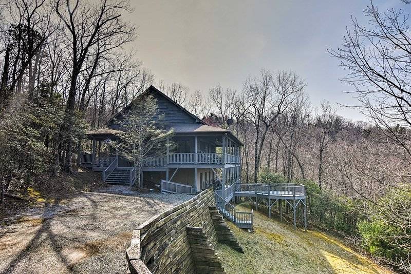The mountains await at this 4-bedroom, 2.5-bath vacation rental cabin!