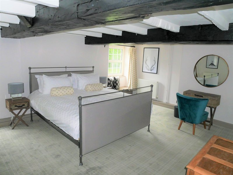 Spacious en suite master bedroom with super king sized bed