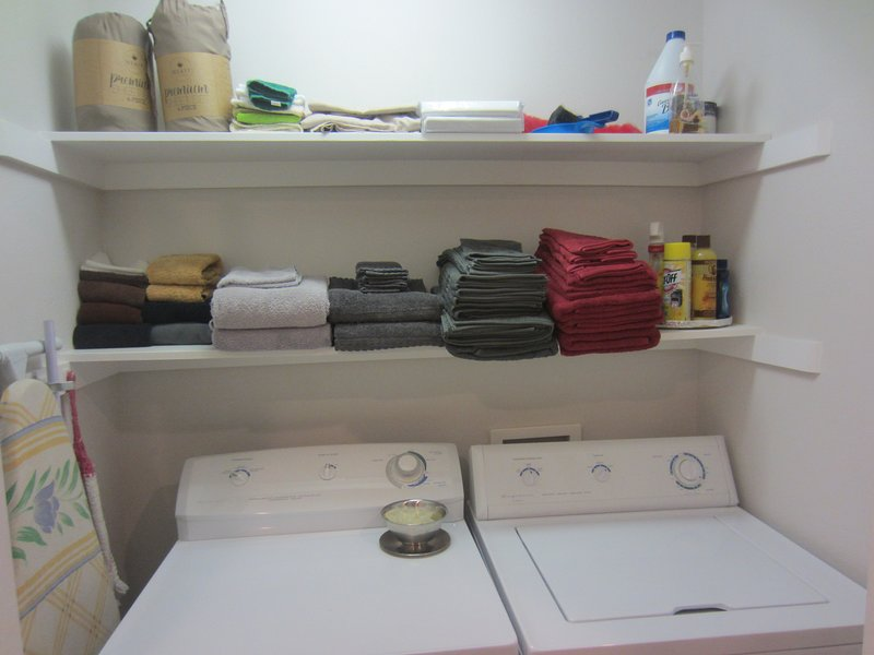 FULL SIZE WASHER AND DRYER, (BEHIND BI-FOLD DOORS) SUPPLIES FURNISHED.