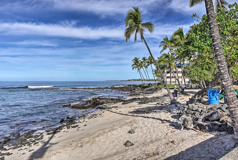 Nestled right on Alii Drive, this waterfront home offers a private beach.