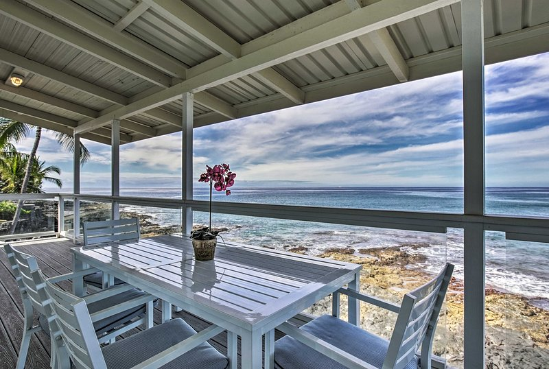 Grab a seat for a meal together on the water at this lovely vacation rental home
