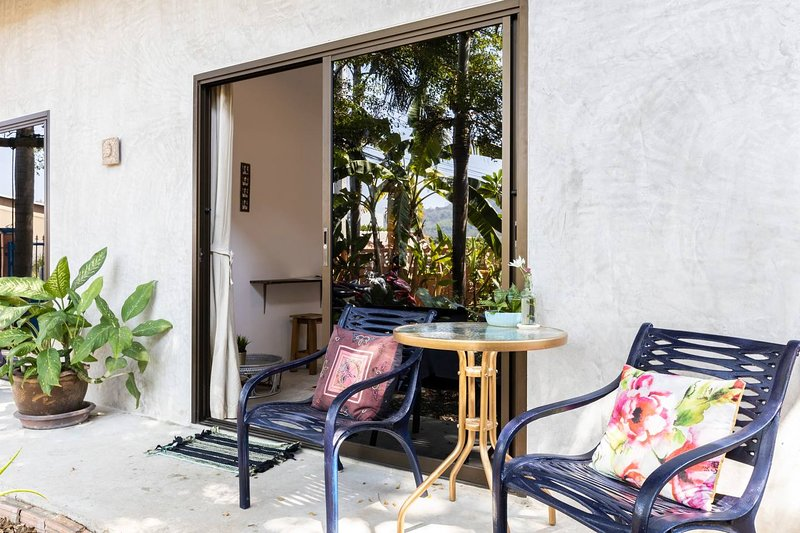 Enjoy the garden from your terrace. It's tropical & lots of shady trees.