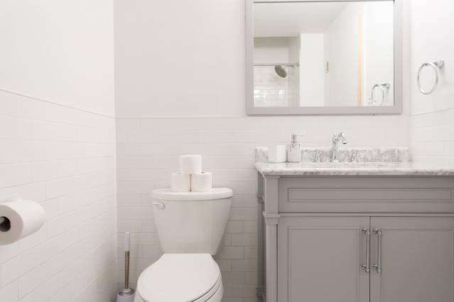 Crisp, clean lines make the bathroom pop.