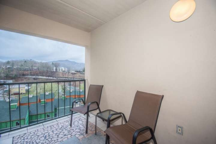 Balcony seating for two with views of downtown Gatlinburg.