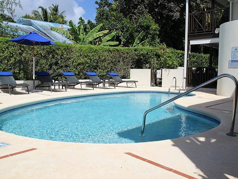 Pool area with loungers, brollies and tables