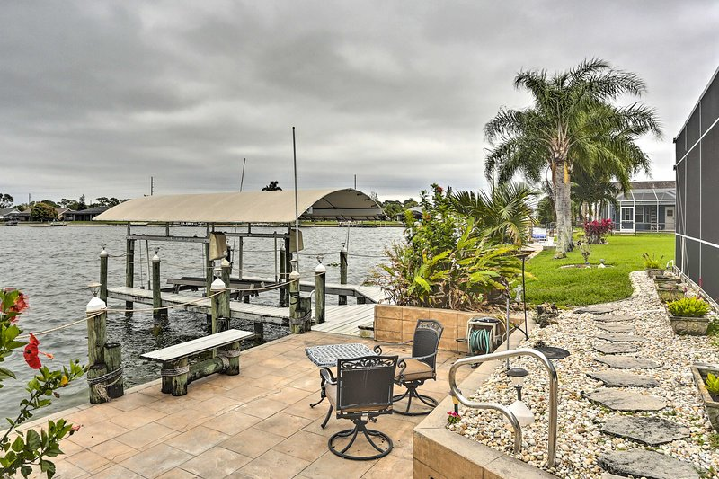 Just outside of the lanai is the home's private dock with canal access!