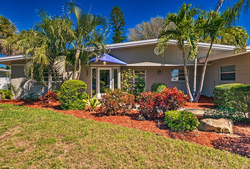 The 3-bedroom, 2-bathroom Siesta Key home boasts a heated pool and canal access!