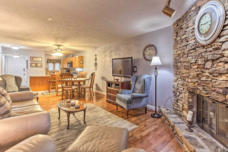The 2BR, 2-bath condo has a living room with a large flat-screen cable TV.