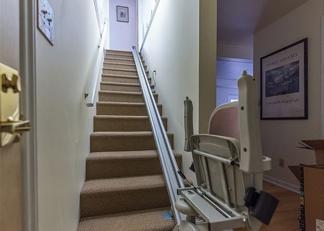 Stairs down to basement. Chair lift is accessible.