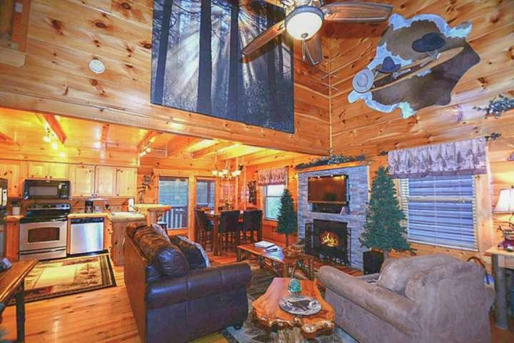 This open area living room has everything right at your fingertips, or simply go out on the deck and enjoy the hot tub!
