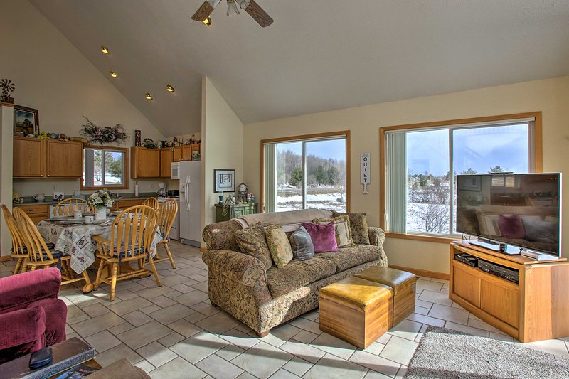 Enjoy a relaxing respite in an open living space after a long day of recreation.