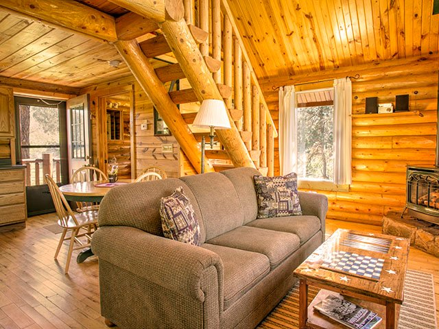 The cabin has a small back deck that overlooks the 109-Mile Mickelson Hiking and Biking Trail.