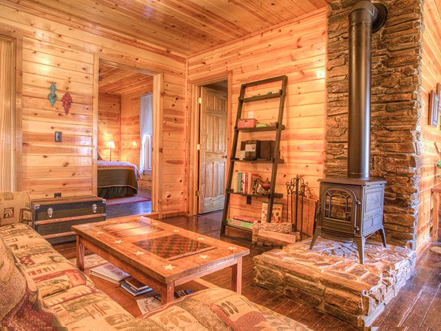 Grandma's Ranch House is cozy and features a wood-burning stove and warm lighting.