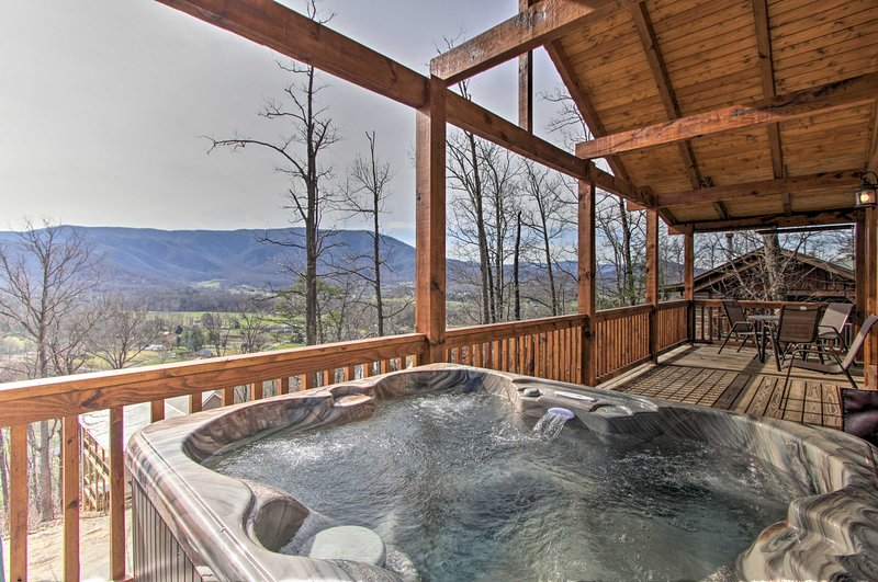 This vacation rental cabin has a private hot tub.