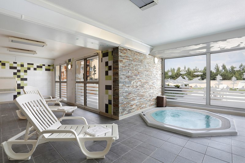 Relax and enjoy the shared hot tub in the paid wellness centre!