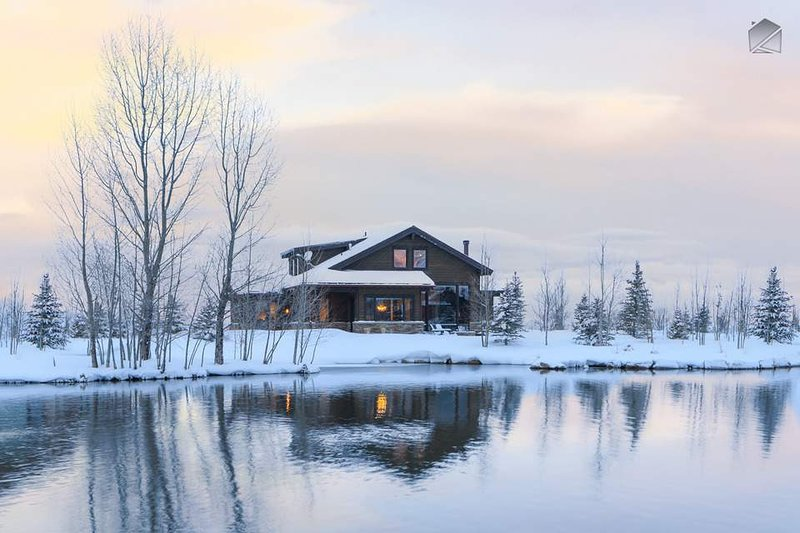 The home is set on a pond stocked with trout, and is excellent for paddleboarding in the summer.