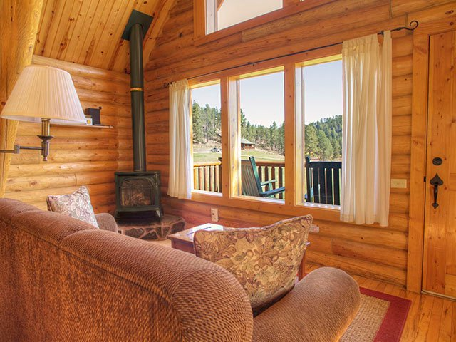 A warm interior looks out onto the deck and the meadow beyond which is often filled with deer.