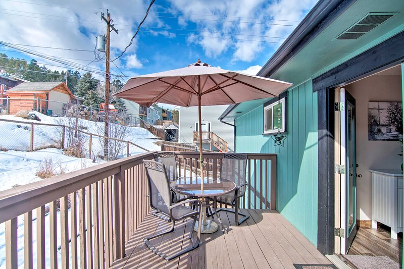 The 3-bedroom, 2-bathroom home features a deck and mountain views.