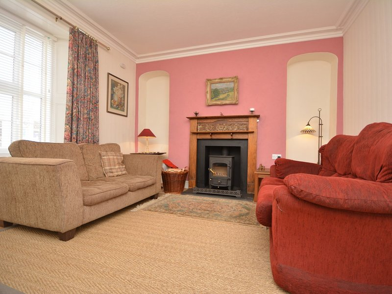 Relax in the cosy lounge with wood burner