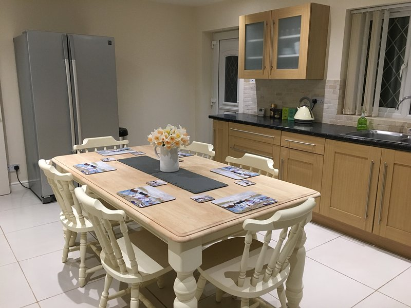 kitchen with American style fridge freezer and seating for up to 8 people