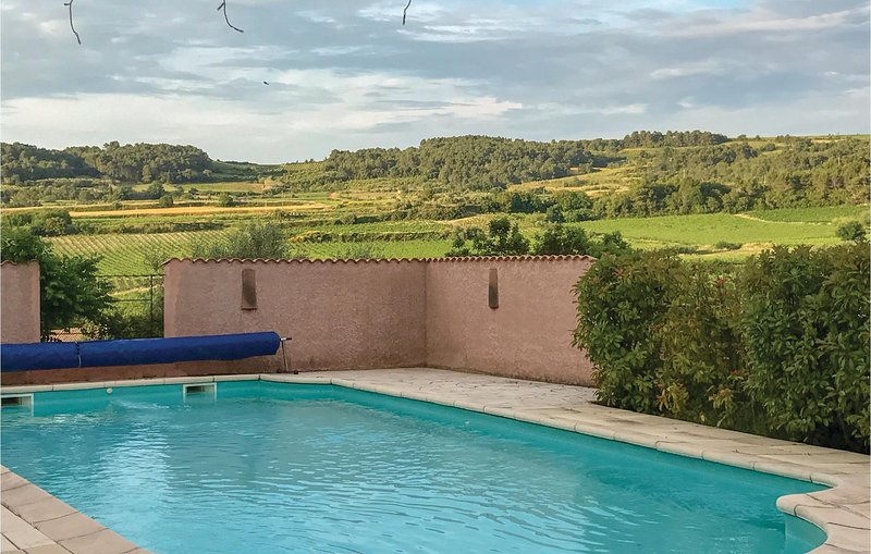 Beautiful home in Curzy with Outdoor swimming pool, WiFi and 4 Bedrooms (FLH462), holiday rental in Argeliers